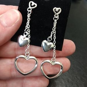 Silver tone dangling heart earrings